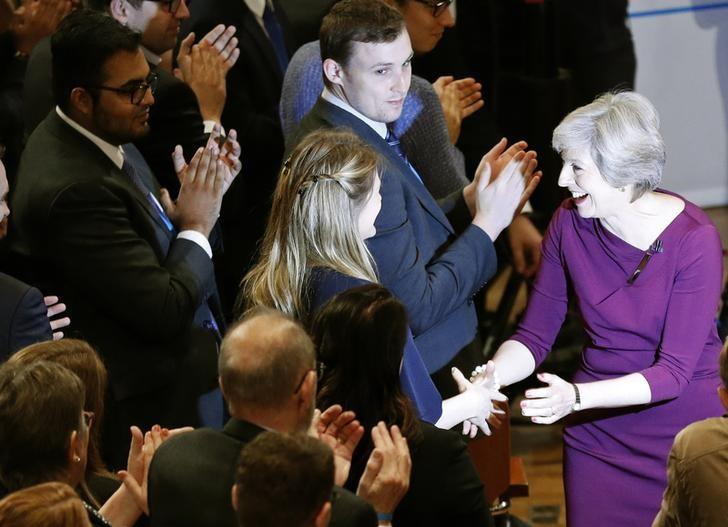 Britain's Prime Minister Theresa May shakes hands with delegates as she leaves the stage after giving her speech on the final day of the annual Conservative Party Conference in Birmingham, Britain, October 5, 2016.       REUTERS/Darren Staples