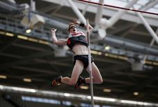 Canada's Shawn Barber in action during the men's pole vault final. Reuters / Phil Noble