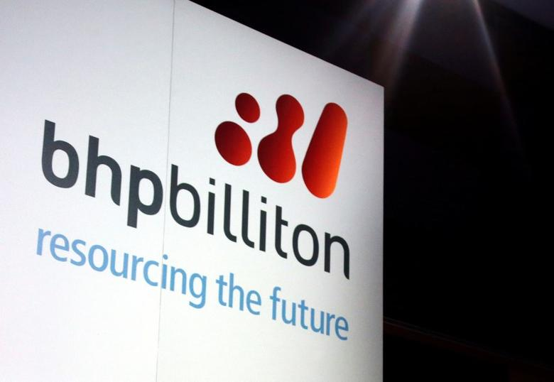 A promotional sign adorns a stage at a BHP Billiton function in central Sydney, Australia August 20, 2013. REUTERS/David Gray/File Photo