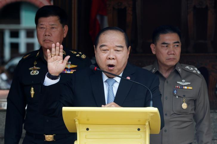 Thailand's Deputy Prime Minister and Defence Minister Prawit Wongsuwan (C) speaks during a news conference after a National Security Council meeting as Thailand's national police chief Jakthip Chaijinda (R) and The Commander-in-Chief of the Royal Thai Army, Teerachai Nakwanich listen at Government House in Bangkok, Thailand, August 15, 2016.  REUTERS/Chaiwat Subprasom/Files