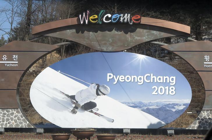 The advertising hoarding promoting the 2018 Winter Olympics stands in the mountain cluster of PyeongChang February 9, 2015. REUTERS/Pawel Kopczynski/Files