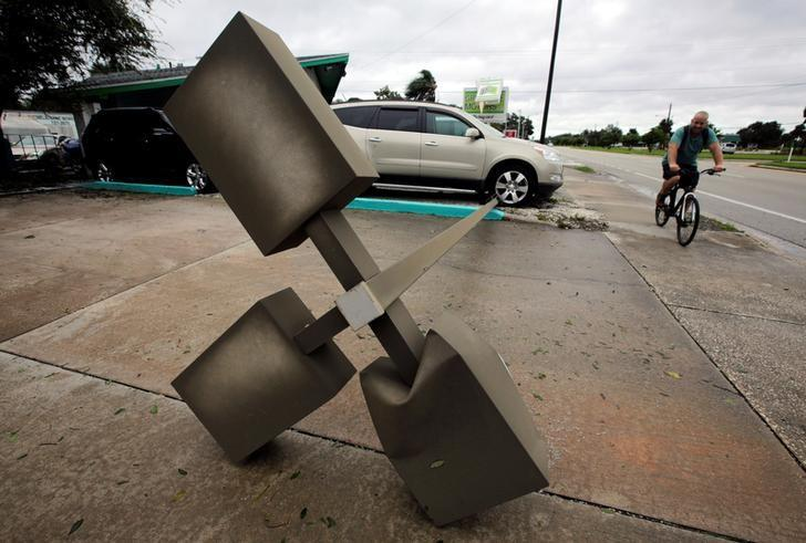 A lamp post is seen on a sidewalk after Hurricane Matthew hits, in Melbourne, Florida, U.S., October 7, 2016. REUTERS/Henry Romero
