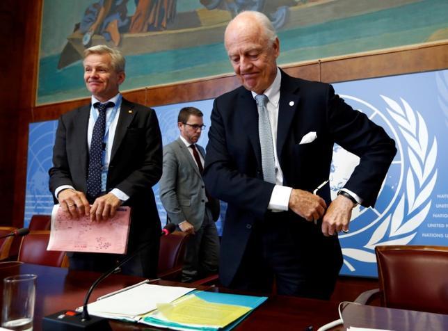 U.N. mediator for Syria Staffan de Mistura (R) reacts next to U.N. Special Advisor Jan Egeland (L) after a news conference at the United Nations in Geneva, Switzerland October 6, 2016. REUTERS/Denis Balibouse