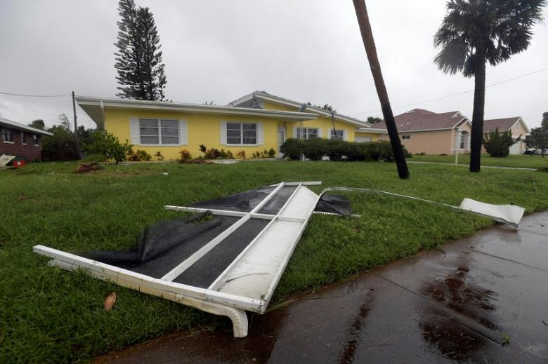 Debris lies in front of a house after the eye of Hurricane Matthew passed Daytona Beach, Florida, U.S., October 7, 2016. REUTERS/Phelan Ebenhack