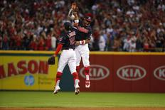 Cleveland Indians shortstop Francisco Lindor (12) and center fielder Rajai Davis (20) celebrate after defeating the Boston Red Sox during game two of the 2016 ALDS playoff baseball series at Progressive Field. Mandatory Credit: Rick Osentoski-USA TODAY Sports