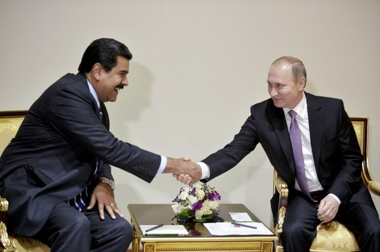 Russia's President Vladimir Putin (R) meets with Venezuela's President Nicolas Maduro on the sidelines of the Gas Exporting Countries Forum (GECF) in Tehran, Iran, in this file photo dated November 23, 2015. REUTERS/Alexei Druzhinin/Sputnik/Kremlin
