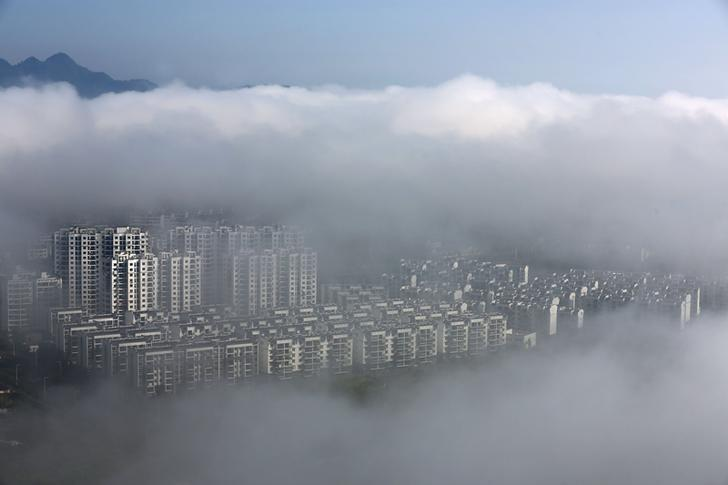 Residential buildings are seen after rain in Huangshan, Anhui province, China May 12, 2016. REUTERS/Stringer
