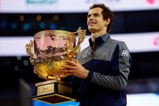 Tennis - China Open men's singles final - Beijing, China - 09/10/16. Britain's Andy Murray holds his trophy after defeating Bulgaria's Grigor Dimitrov. REUTERS/Thomas Peter