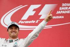 Formula One - Japanese Grand Prix - Suzuka Circuit, Japan- 9/10/16. Mercedes' driver Nico Rosberg of Germany celebrates winning the race. REUTERS/Toru Hanai