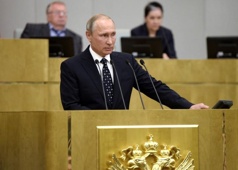 Russian President Vladimir Putin delivers a speech during the opening session of the newly-elected State Duma, the lower house of parliament, in Moscow, Russia, October 5, 2016. Sputnik/Kremlin/Alexei Nikolskyi via REUTERS