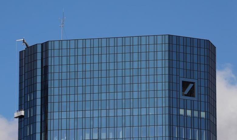 Window cleaners are working on the facade of the headquarters of Germany's Deutsche Bank in Frankfurt, Germany, October 5, 2016.   REUTERS/Kai Pfaffenbach