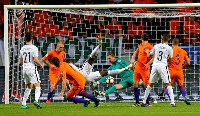 Football Soccer - Netherlands v France - World Cup 2018 Qualifier- Arena Stadion, Amsterdam, 10/10/16.    France's Paul Pogba and Netherland's goalkeeper Maarten Stekelenburg in action.     REUTERS/Michael Kooren