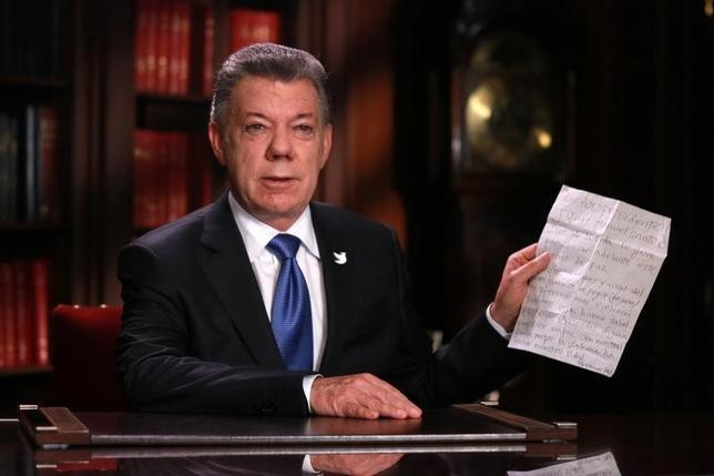 10月10日、コロンビア政府と同国第2の左翼ゲリラ勢力である民族解放軍(ELN)は、正式な和平交渉を27日に開始すると発表した。写真はサントス大統領。ボゴタで撮影されたもの。第三者提供(2016年 ロイター)