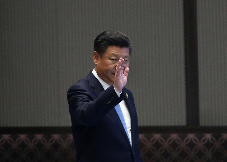 China's President Xi Jinping waves as he arrives at a news conference after the closing of G20 Summit in Hangzhou, Zhejiang Province, China, September 5, 2016. REUTERS/Damir Sagolj/Files