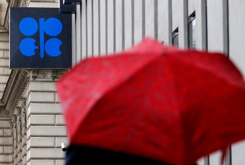 A person carrying an umbrella walks by the Ogranization of the Petroleum Exporting Countries (OPEC) headquarters in Vienna, Austria October 4, 2016. REUTERS/Heinz-Peter Bader