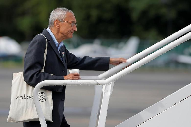 John Podesta, campaign chairman for U.S. Democratic presidential candidate Hillary Clinton, boards her campaign plane in White Plains, New York, U.S., September 27, 2016.  REUTERS/Brian Snyder