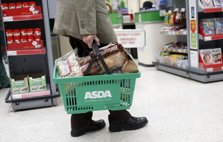 A customer carries a shopping basket at an Asda store in northwest London, Britain, in this file photograph dated August 18, 2015. REUTERS/Suzanne Plunkett/files
