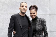U.S. singer Janet Jackson (R) and her then boyfriend Wissam Al Mana pose for photographers as they arrive to attend the Giorgio Armani Autumn/Winter 2013 collection at Milan Fashion Week, February 25, 2013.      REUTERS/Alessandro Garofalo/File Photo