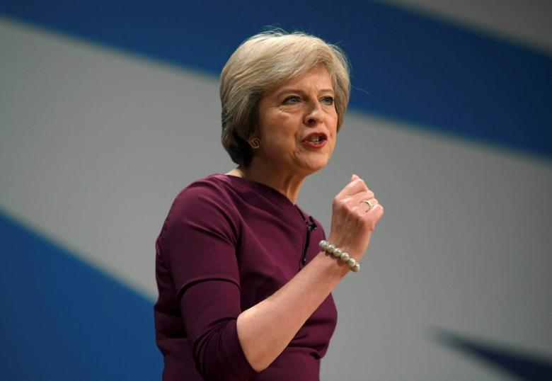 Prime Minister Theresa May gives her speech on the final day of the annual Conservative Party Conference in Birmingham, Britain, October 5, 2016. REUTERS/Toby Melville/File Photo