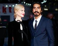 """Nicole Kidman poses alongside Dev Patel as they arrive for the gala screening of the film """"Lion"""", during the 60th British Film Institute (BFI) London Film Festival at Leicester Square in London, Britain October 12, 2016.   REUTERS/Peter Nicholls"""