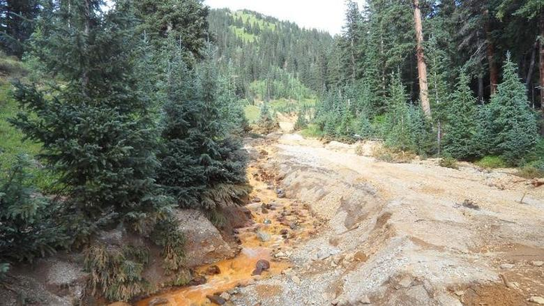 Yellow mine waste water from the Gold King Mine is seen in San Juan County, Colorado, in this picture released by the Environmental Protection Agency (EPA) taken August 7, 2015.   REUTERS/EPA/Handout