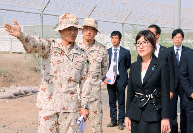 Japan's Defence Minister Tomomi Inada (front, R) is briefed by senior Self-Defense Forces personnel about their anti-piracy mission off Somalia, in Djibouti, August 15, 2016. Mandatory credit Kyodo/via REUTERS