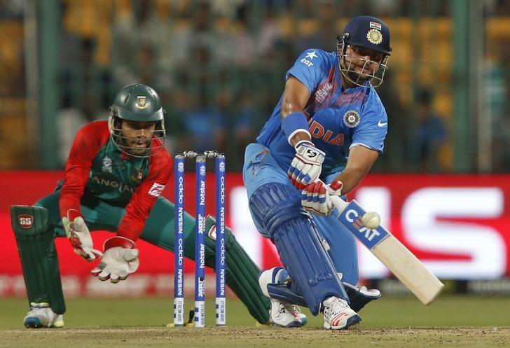 Cricket - India v Bangladesh - World Twenty20 cricket tournament - Bengaluru, India, 23/03/2016. Suresh Raina (R) plays a shot watched by Bangladesh's wicketkeeper Mushfiqur Rahim.   REUTERS/Danish Siddiqui/Files