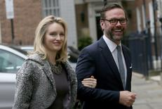 James Murdoch, the son of media mogul Rupert Murdoch, and his wife Kathryn Hufschmid arrive for a reception to celebrate the wedding between Rupert Murdoch and former supermodel Jerry Hall which took place on Friday, in London, Britain March 5, 2016. REUTERS/Neil Hall