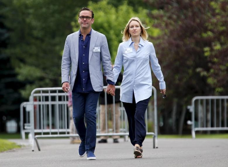 James Murdoch walks with his wife Kathryn as they arrive for the first day of the annual Allen and Co. media conference in Sun Valley, Idaho July 8, 2015.  REUTERS/Mike Blake