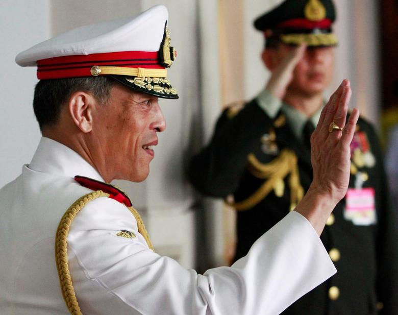Thailand's Crown Prince Maha Vajiralongkorn waves to well-wishers who had gathered to see King Bhumibol Adulyadej before he departed to the Grand Palace from Siriraj Hospital to take part in his coronation anniversary ceremonies in Bangkok, Thailand May 5, 2010.  REUTERS/Sukree Sukplang/File Photo