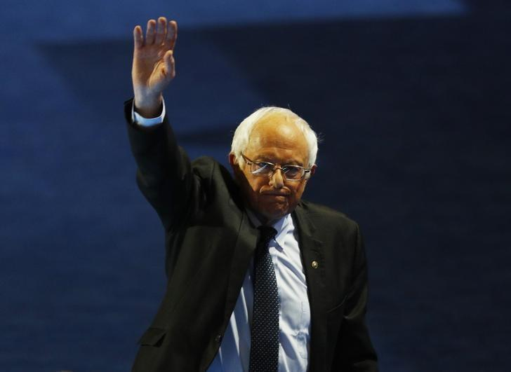 Senator Bernie Sanders (D-VT) waves while leaving the stage after addressing the Democratic National Convention in Philadelphia, Pennsylvania, U.S. July 25, 2016. REUTERS/Scott Audette - RTSJMU9