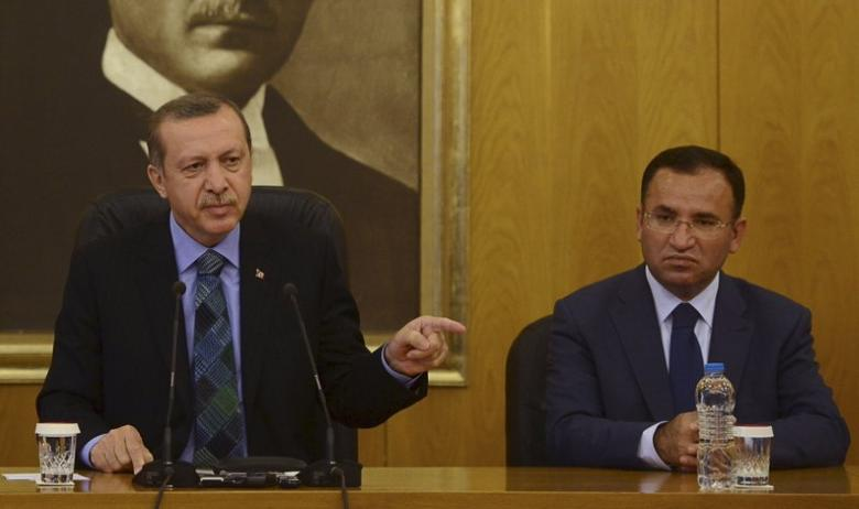 Turkey's Prime Minister Tayyip Erdogan, accompanied by his deputies Bulent Arinc (not pictured) and Bekir Bozdag (R), speaks during a news conference at Ataturk International Airport in Istanbul in this June 3, 2013 file photo.  REUTERS/Stringer/Files