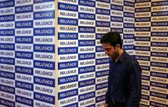 A man walks out of a meeting hall during the annual general meeting of Reliance Communication in Mumbai September 30, 2014. REUTERS/Shailesh Andrade
