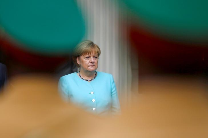 German Chancellor Angela Merkel listens to the national anthems at the National Palace in Ethiopia's capital Addis Ababa October 11, 2016. REUTERS/Tiksa Negeri