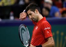 Tennis - Shanghai Masters tennis tournament - Novak Djokovic of Serbia v Roberto Bautista Agut of Spain - Shanghai, China - 15/10/16. Djokovic wipes his forehead. REUTERS/Aly Song