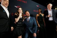 """Cast member Ben Affleck (3rd L) poses with co-star Anna Kendrick (2nd L), as cast members J.K. Simmons (L), Cynthia Addai-Robinson and John Lithgow watch, at the premiere of """"The Accountant"""" at the TCL Chinese theatre in Hollywood, California U.S., October 10, 2016.   REUTERS/Mario Anzuoni"""