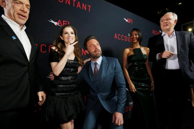 Cast member Ben Affleck (3rd L) poses with co-star Anna Kendrick (2nd L), as cast members J.K. Simmons (L), Cynthia Addai-Robinson and John Lithgow watch, at the premiere of ''The Accountant'' at the TCL Chinese theatre in Hollywood, California U.S., October 10, 2016.   REUTERS/Mario Anzuoni