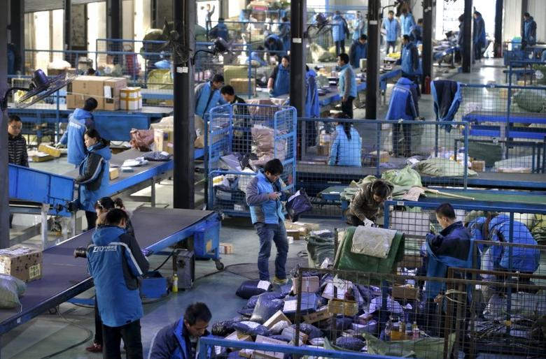 Employees work at a sorting centre of Zhongtong (ZTO) Express ahead of the Singles Day shopping festival, Chaoyang District, Beijing, November 8, 2015. REUTERS/Jason Lee