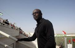 Former French soccer player Lilian Thuram attends an inauguration ceremony of a renovated football stadium in the West bank town of Al-Bireh near Ramallah April 14, 2011. REUTERS/Abed Omar Qusini