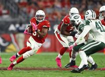 Oct 17, 2016; Glendale, AZ, USA; Arizona Cardinals running back David Johnson (31) runs the ball against the New York Jets at University of Phoenix Stadium. The Cardinals defeated the Jets 28-3. Mandatory Credit: Mark J. Rebilas-USA TODAY Sports