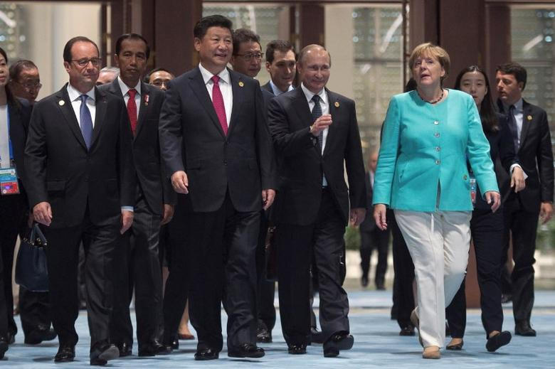 French President Francois Hollande, Chinese President Xi Jinping, Russian President Vladimir Putin and German Chancellor Angela Merkel arrive for the opening ceremony of the G20 Summit in Hangzhou, China September 4, 2016. REUTERS/Nicolas Asfouri/Pool