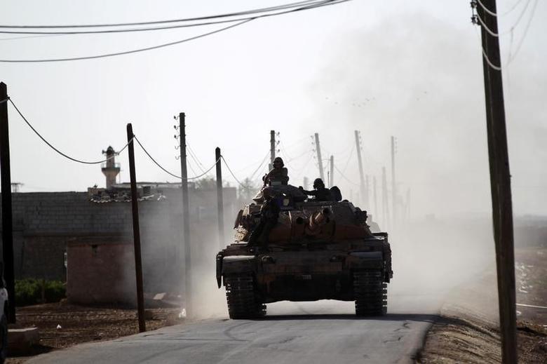A Turkish tank drives near Guzhe village, northern Aleppo countryside, Syria October 17, 2016. REUTERS/Khalil Ashawi