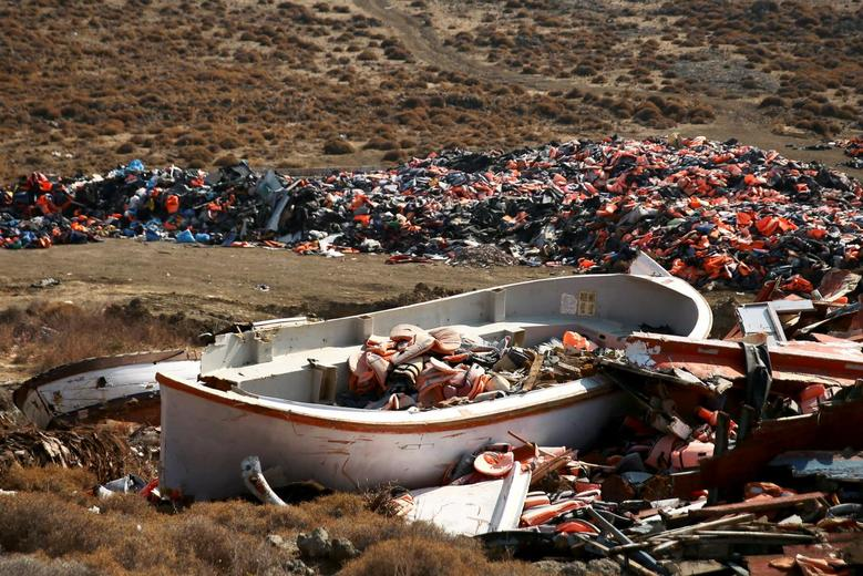 Lifejackets are seen inside a wrecked boat used by refugees and migrants to cross part of the Aegean Sea from Turkey to Greece at a garbage dump site of thousands of lifejackets, near the town of Mithymna (also known as Molyvos) on the island of Lesbos, Greece, October 5, 2016. REUTERS/Alkis Konstantinidis