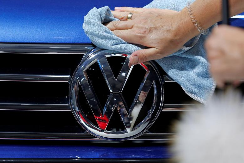 A worker shines the grill of a Volkswagen car displayed on media day at the Paris auto show, in Paris, France, September 30, 2016. REUTERS/Benoit Tessier