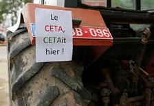 """A sign reading """"The CETA was yesterday!"""" is seen on a tractor outside the Walloon regional parliament as deputies attend a debate on the Comprehensive Economic and Trade Agreement (CETA), a planned EU-Canada free trade agreement, in Namur, Belgium, October 14, 2016. REUTERS/Francois Lenoir"""