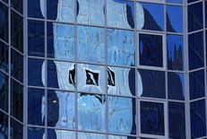 The logo of Germany's Deutsche Bank is reflected in the windows of a skyscraper in Frankfurt, Germany, October 5, 2016.   REUTERS/Kai Pfaffenbach