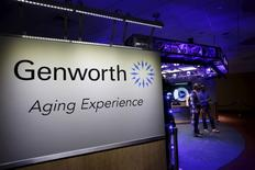George Twopointoh, brand ambassador for Genworth, speaks with Ugo Dumont, a volunteer for the Genworth R70i Aging Experience, during a demonstration at the Liberty Science Center in Jersey City, New Jersey in this file photo dated April 5, 2016.   REUTERS/Shannon Stapleton