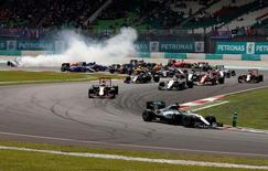 Formula One - F1 - Malaysia Grand Prix - Sepang, Malaysia- 2/10/16  Mercedes' Lewis Hamilton of Britain leads as Mercedes' Nico Rosberg of Germany skids to the back during the first lap of the race. REUTERS/Edgar Su
