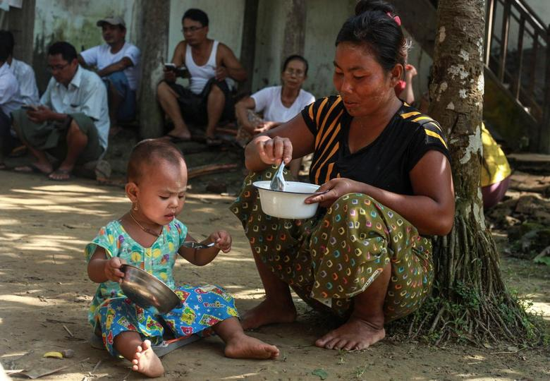 An ethnic Rakhine woman who fled from recent violence in Maungdaw feeds her daughter at a monastery used as a temporary internally displaced persons (IDP) camp in Sittwe, Myanmar October 15, 2016. REUTERS/Wa Lone