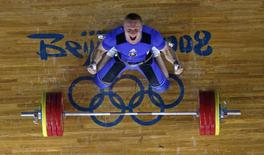 Andrei Rybakou of Belarus reacts after lifting 209kg in the men's 85kg Group A clean and jerk weightlifting competition at the Beijing 2008 Olympic Games August 15, 2008.     REUTERS/Yves Herman